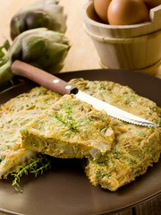 omelette with artichokes and knife