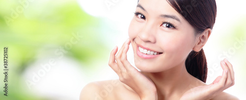 close up of Beauty woman Face and hand touch