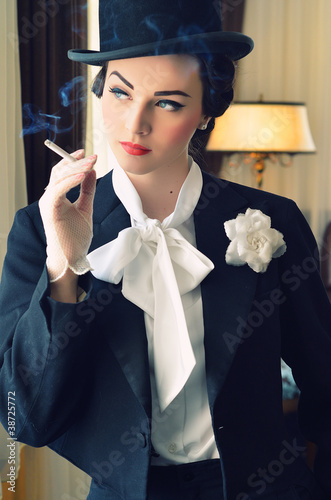 Beautiful girl in  old suit