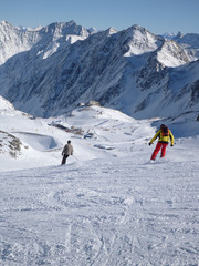 Vertical shot of skiers on a mountain