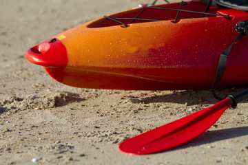 Part of a kayak on a beach