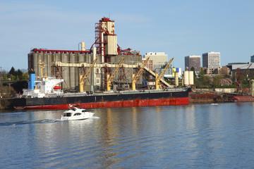 Grain elevator & ship (exports).