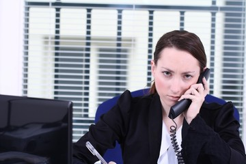 frustrated young woman at Work