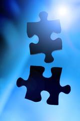 Zwei Puzzleteile als Sinnbild für Zusammenarbeit