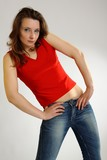 Young sexy girl in red shirt and blue jeans