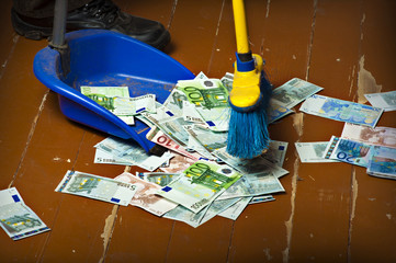 Sweeping euro money banknotes