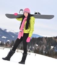 Woman holding snowboard