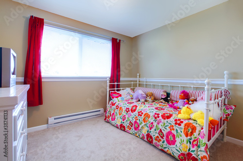 Kids room with girl flowery bed and to