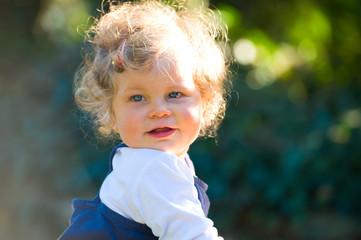 sweet little girl in back light