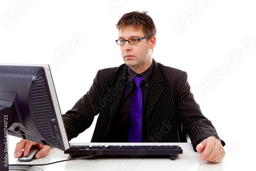 Businessman sitting behind desk at work