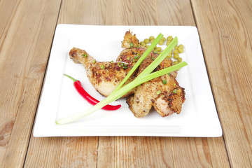 quarter chicken garnished with green sweet peas