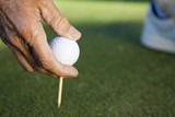 Senior Man Hand Golf Ball & Tee