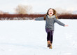 girl running on snow in park