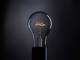 Light bulb over dark background