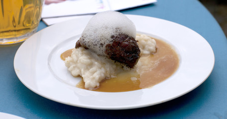 Glazed cheek of Iberian pork in sherry and cream with rice and m