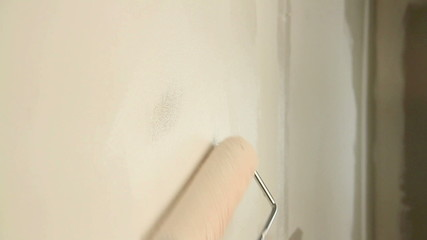 Painting out a bare wall with a paint roller