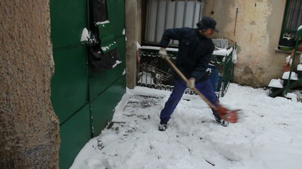 Man shoveling snow in the courtyard