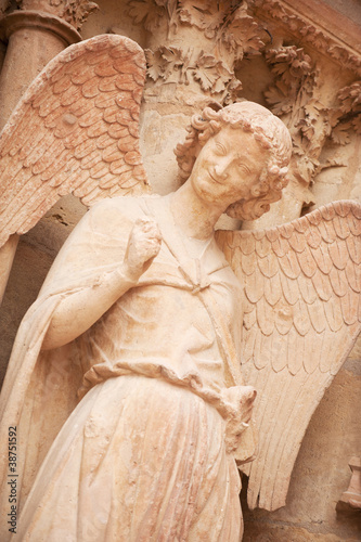 Famous smiling angel on facade of Reims Cathedral