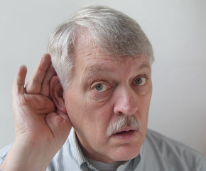 older man is hard of hearing