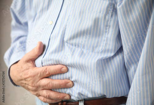 businessman with indigestion or stomach pain