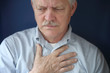 older man feeling pain in chest