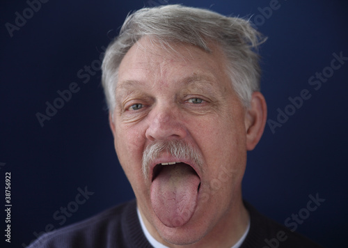 older man showing his tongue