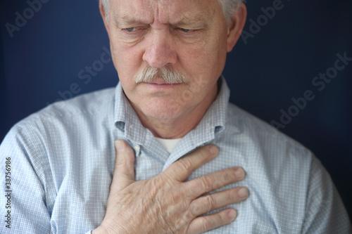 older man feeling pain in chest