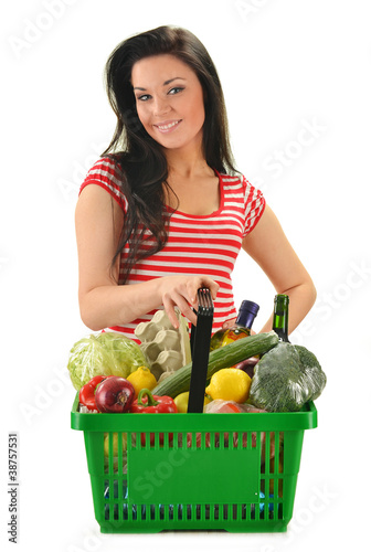 Young woman with shopping basket isolated on white