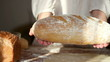 Baker shows fresh-baked bread