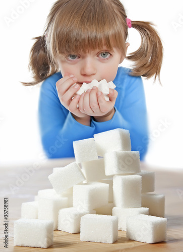 little girl with sugar cubes