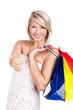 junge blonde Frau mit Einkaufstaschen und Daumen-Hoch-Geste