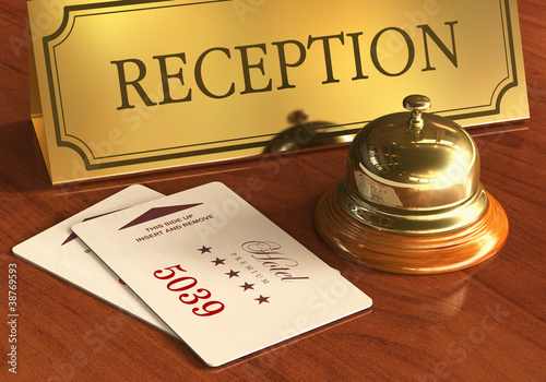 Service bell and cardkeys on hotel reception desk