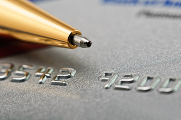 Credit card and pen as a background.