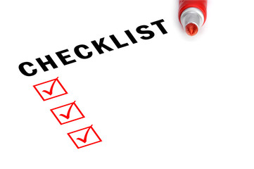 Checklist with marker and checked boxes.