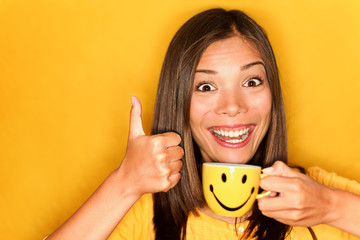 Woman drinking coffee happy thumbs up