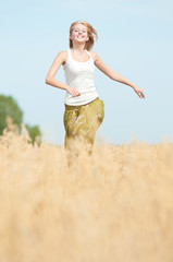 Happy woman on picnic in wheat field
