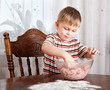 A boy is mixing mincemeat in a bowl