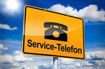 Ortseingangsschild mit Service-Telefon