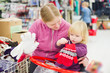 Mother and daughter look glowes in supermarket.