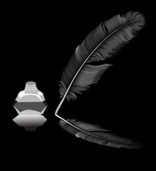 feather in inkstand isolated on black