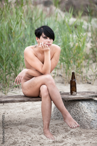 Naked woman with cigarette