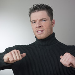 annoyed man accusing himself