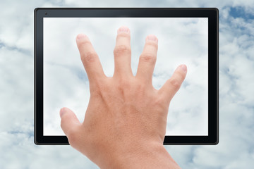 Hand touching tablet in cloud
