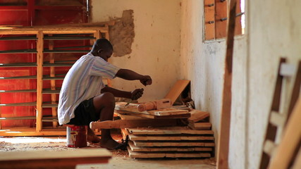 Man chiseling wood in Kenya.