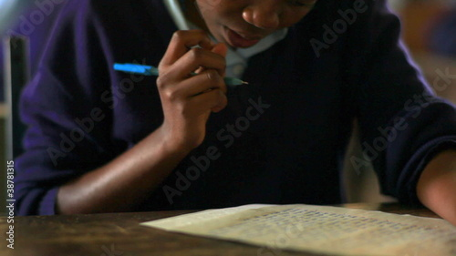 Close up of a student working in class in Kenya.