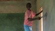 Painting the interior of a school in a village in Kenya.