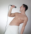 muscular man singing after his shower