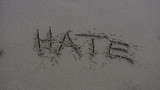 HATE' Washed Away on the Beach