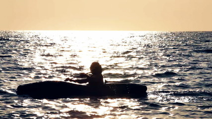 Man in the canoe in a sea