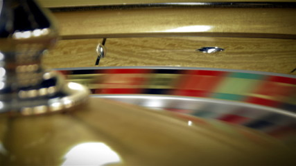 Close up of a roulette table spinning with the ball.